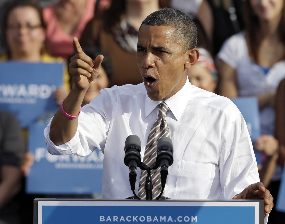 Photo -   President Obama gestures while speaking at a campaign event at Ybor Centennial Park in Tampa, Fla., Thursday, Oct. 25, 2012. The president is on the second day of his 48 hour, 8 state campaign blitz. (AP Photo/Chris O'Meara)