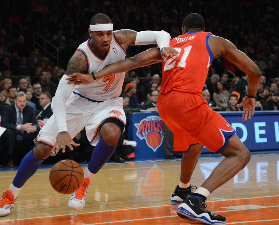 New York Knicks\' Carmelo Anthony, left, drives on the Philadelphia 76ers\' Thaddeus Young in the first quarter of the NBA basketball game at Madison Square Garden in New York, Sunday, Nov. 4, 2012. (AP Photo/Henny Ray Abrams)