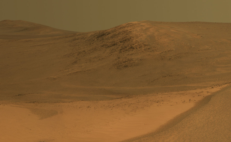 Photo - A NASA naming convention decided to name a hill on Mars after former employee Richard Morris shortly after his death in 2011. This picture of Morris Hill is kept framed inside his parents' home. PHOTO PROVIDED