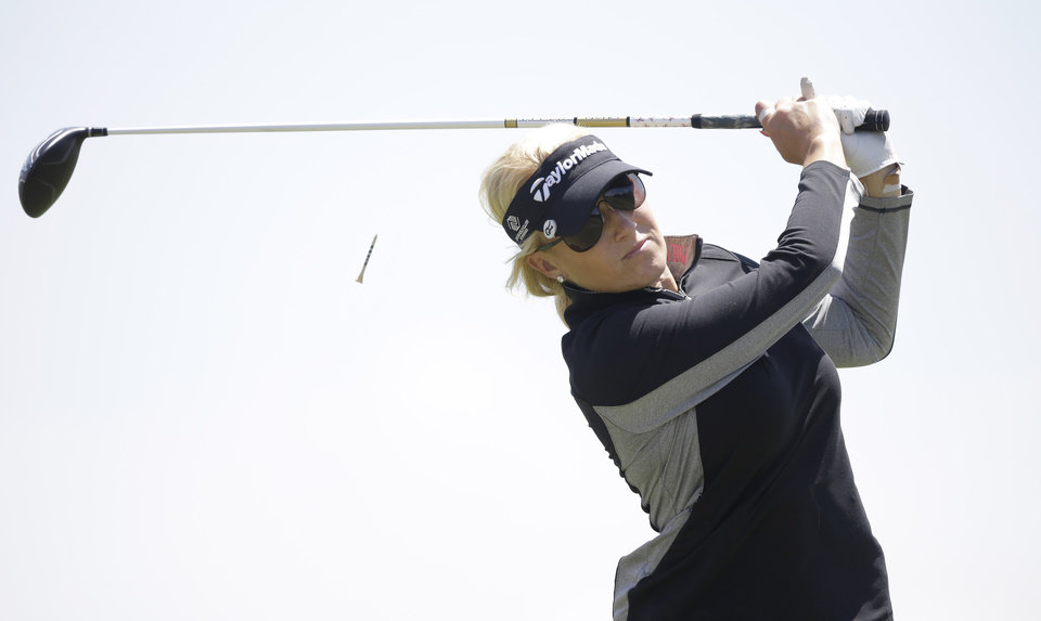Photo - Natalie Gulbis tees off on the ninth hole during the second round of the North Texas LPGA Shootout golf tournament at  the Las Colinas Country Club in Irving, Texas, Friday, May 2, 2014. (AP Photo/LM Otero)