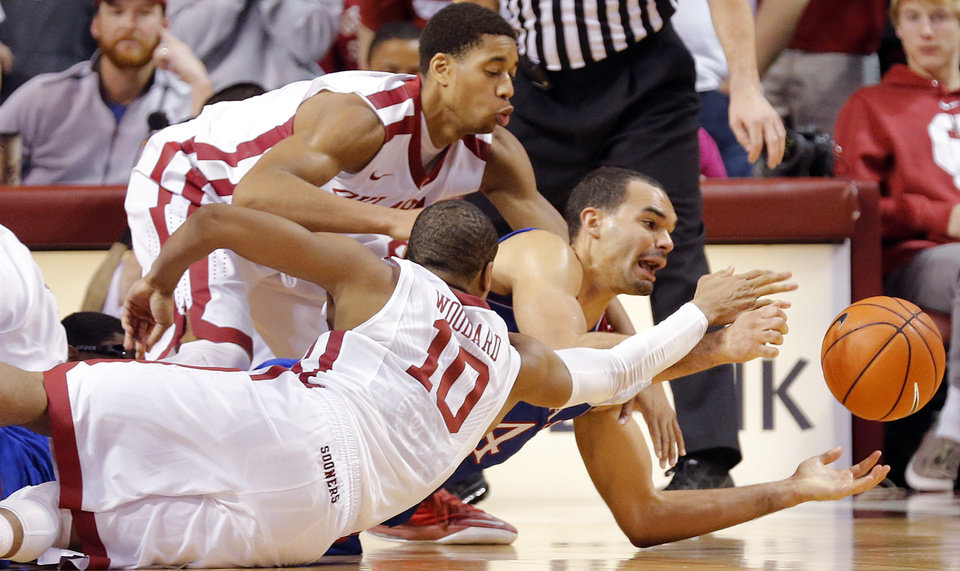 Photo - Kansas' Perry Ellis (34) fights for a loose ball with Oklahoma's Isaiah Cousins (11) and Jordan Woodard (10) during the NCAA college basketball game between the University of Oklahoma Sooners (OU) and the University of Kansas (KU) Jayhawks at Lloyd Nobel Center in Norman,  Okla. on Wednesday, Jan. 8, 2014.   .Photo by Chris Landsberger, The Oklahoman