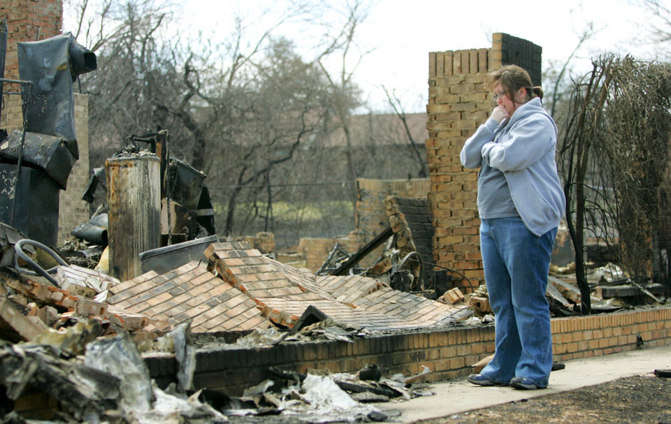 Shelly Evans looks at the remains of her grandmother's home at 208 Oine Tree road that was destroyed in a wildfire in Choctaw, Oklahoma April 10, 2009.  Photo by Steve Gooch, The Oklahoman