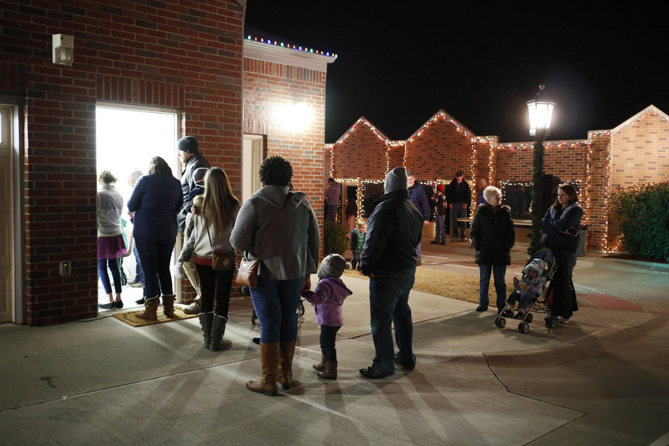 Photo -  People wait in line to build a birdhouse in Santa's workshop during Winter Night at the Children's Safety Village in Edmond. PHOTO BY DOUG HOKE, THE OKLAHOMAN   DOUG HOKE -