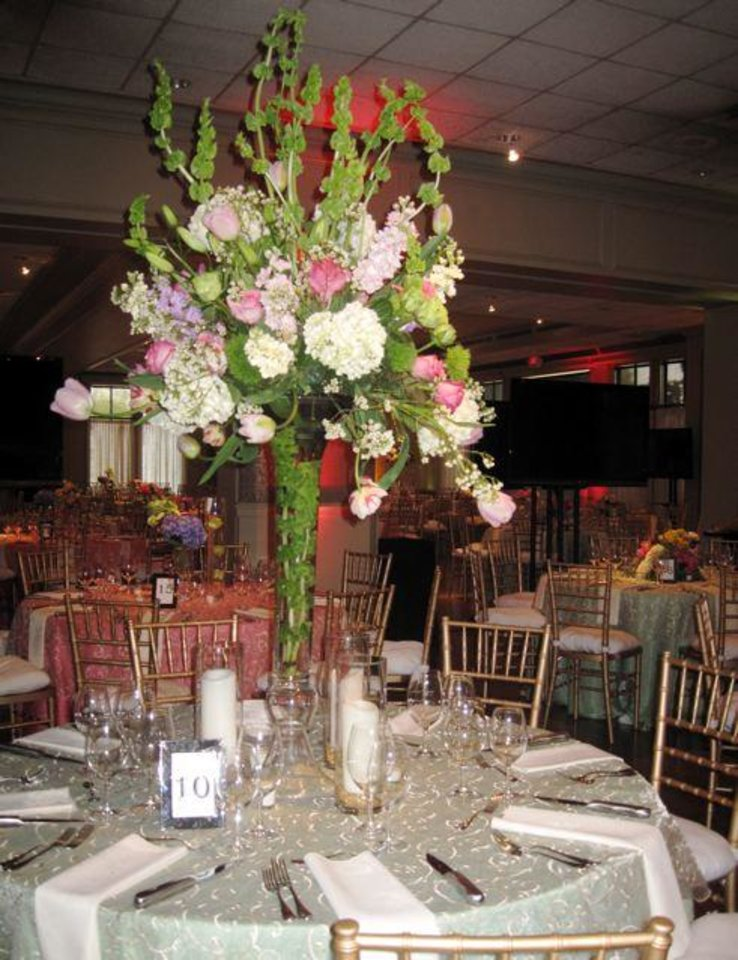 Beautiful flowers by Trochta's decorated the tables. (Photo by Helen Ford Wallace).