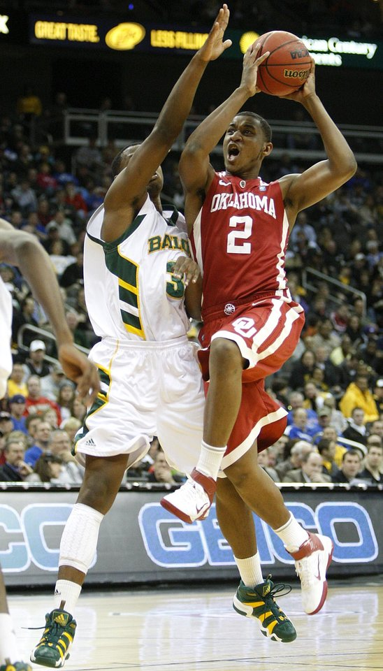 OU's Steven Pledger drives to the basket past Baylor's Fred Ellis during the college basketball Big 12 Championship tournament game between the University of Oklahoma and Baylor in Kansas City, Mo., Wednesday, March 9, 2011.  Photo by Bryan Terry, The Oklahoman