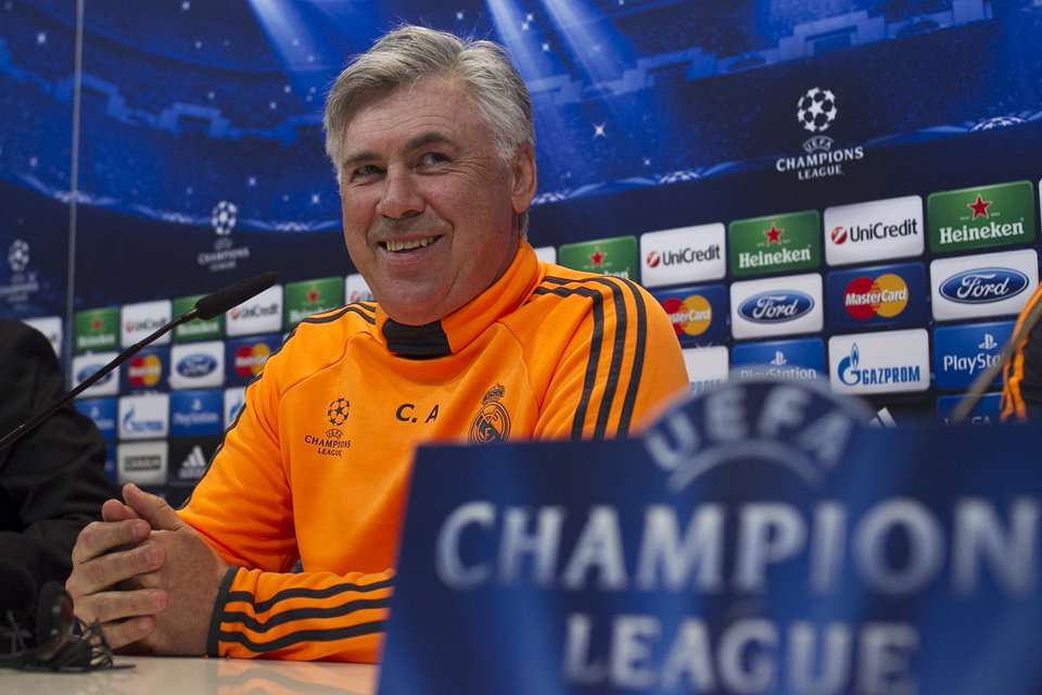 Photo - Real's coach Carlo Ancelotti arrives for a press conference after a training session in Madrid, Spain, Tuesday, April 22, 2014. Real Madrid will face Bayern Munich in a first leg semifinal Champions League soccer match on Wednesday. (AP Photo/Gabriel Pecot)
