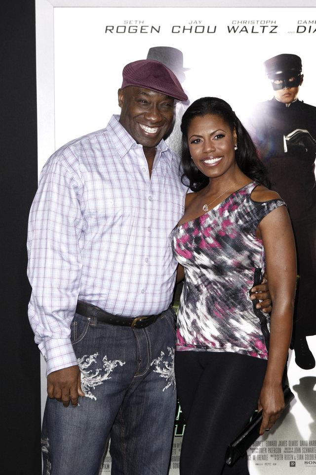Photo -   FILE - In this Monday, Jan 10, 2011 photo, Michael Clarke Duncan, left, and his fiancee Omarosa Manigault arrive at the premiere of