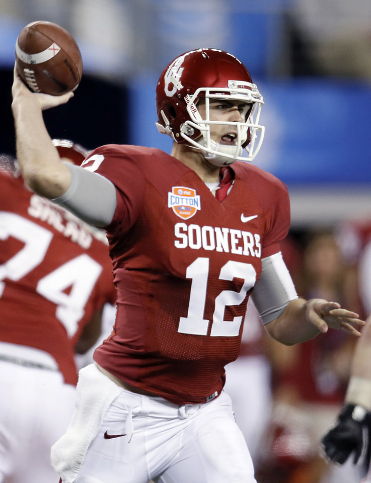 Photo - Oklahoma's Landry Jones (12) passes the ball during the college football Cotton Bowl game between the University of Oklahoma Sooners (OU) and Texas A&M University Aggies (TXAM) at Cowboy's Stadium on Friday Jan. 4, 2013, in Arlington, Tx. Photo by Chris Landsberger, The Oklahoman