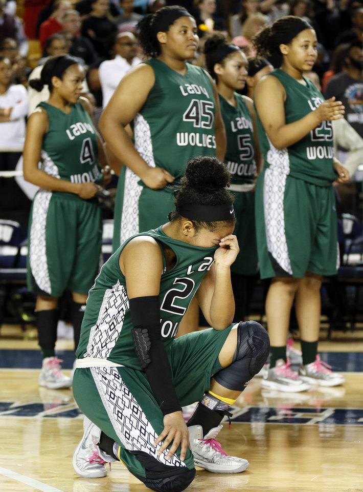 Photo - Edmond Santa Fe's Tamara Lee (20) reacts near her teammates after the Class 6A girls championship game in the state high school basketball tournament between Broken Arrow and Edmond Santa Fe at the Mabee Center in Tulsa, Okla., Saturday, March 15, 2014. Broken Arrow won, 70-51. Photo by Nate Billings, The Oklahoman