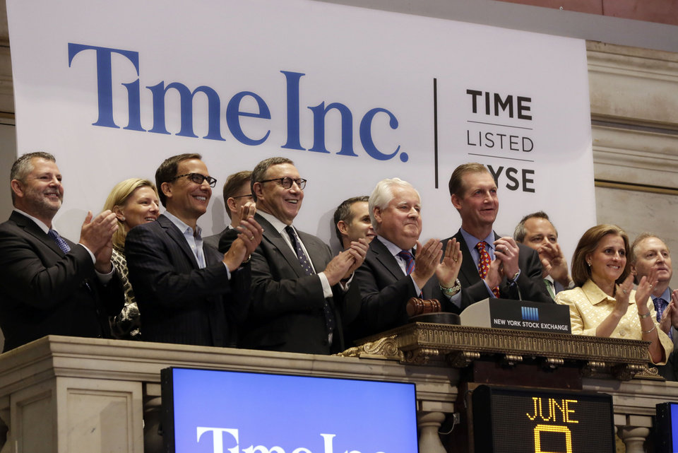 Photo - Time Inc. Chairman and CEO Joseph Ripp, center, joins the applause as he rings the New York Stock Exchange opening bell to mark his company first day of trading as a stand-alone public company, Monday, June 9, 2014. (AP Photo/Richard Drew)