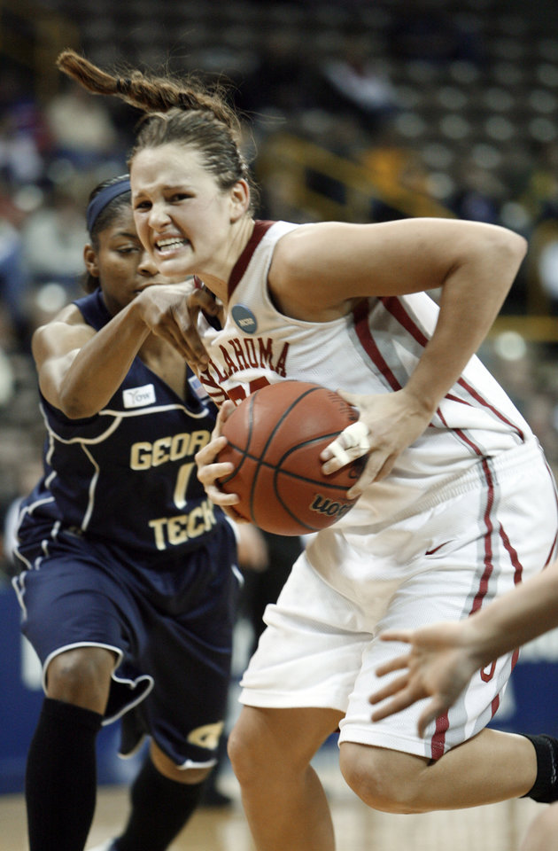 Photo - Whitney Paris drives past Jacqua Williams in the first half as the University of Oklahoma (OU) plays Georgia Tech in round two of the 2009 NCAA Division I Women's Basketball Tournament at Carver-Hawkeye Arena at the University of Iowa in Iowa City, IA on Tuesday, March 24, 2009. 