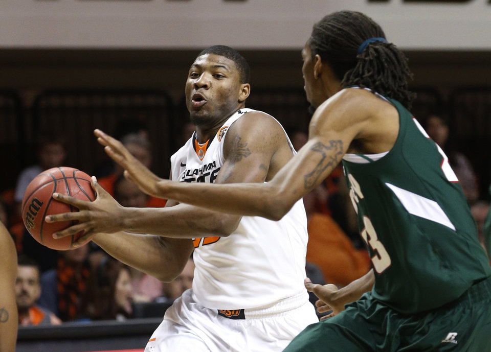 Photo - Oklahoma State guard Marcus Smart (33) drives around Mississippi Valley State guard James Currington (23) in the first half of an NCAA college basketball game in Stillwater, Okla., Friday, Nov. 8, 2013. (AP Photo/Sue Ogrocki)
