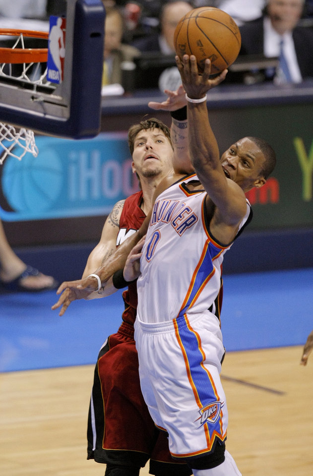 Oklahoma City's Russell Westbrook (0) goes past Miami's Mike Miller (13) during Game 1 of the NBA Finals between the Oklahoma City Thunder and the Miami Heat at Chesapeake Energy Arena in Oklahoma City, Tuesday, June 12, 2012. Photo by Sarah Phipps, The Oklahoman