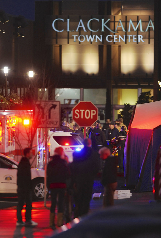 CORRECTS LOCATION OF MALL - Police and medics outside the scene of a multiple shooting at Clackamas Town Center Mall in Portland, Ore., Tuesday Dec. 11, 2012. A gunman is dead after opening fire in the Portland, Ore., shopping mall Tuesday, killing two people and wounding another, sheriff's deputies said. (AP Photo/Greg Wahl-Stephens)