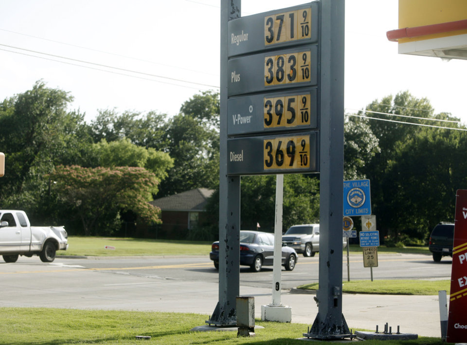 Photo -  Gas prices at a gas station in Oklahoma City reach $3.71 on June 17, 2014. Photo by K.T. King/The Oklahoman   KT King -  The Oklahoman