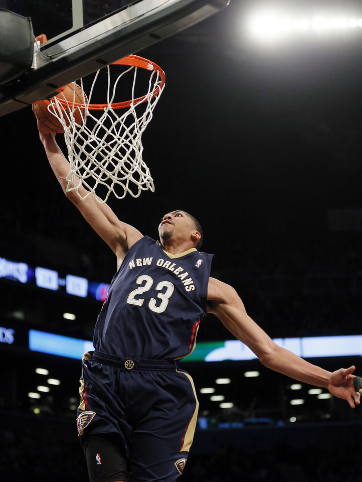Photo - New Orleans Pelicans forward Anthony Davis scores in the first quarter of an NBA basketball game against the Brooklyn Nets on Sunday, Feb. 9, 2014, in New York. (AP Photo/Paul J. Bereswill)