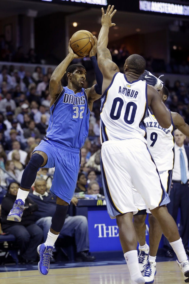 Dallas Mavericks' O.J. Mayo (32) passes the ball over Memphis Grizzlies' Darrell Arthur (00) during the first half of an NBA basketball game in Memphis, Tenn., Friday, Dec. 21, 2012. (AP Photo/Danny Johnston)