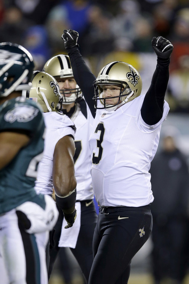 Photo - New Orleans Saints' Shayne Graham celebrates after kicking the game-winning field goal during the second half of an NFL wild-card playoff football game against the Philadelphia Eagles, Saturday, Jan. 4, 2014, in Philadelphia. New Orleans won 26-24. (AP Photo/Michael Perez)