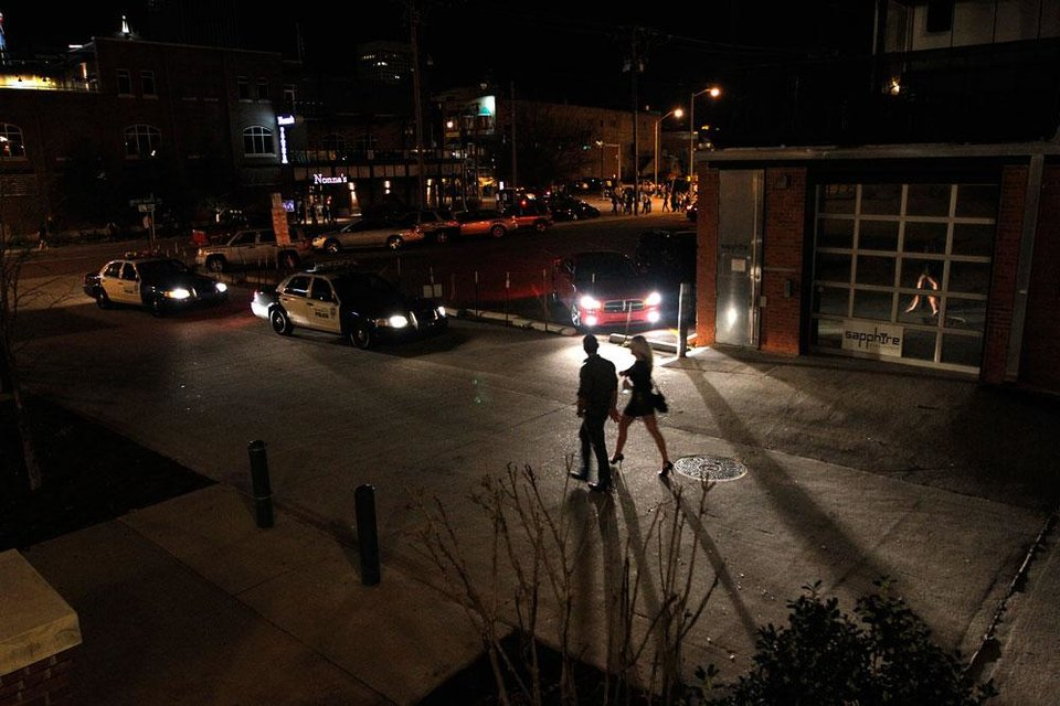 Photo -  People leave bars in the Bricktown area in Oklahoma City, Saturday, March 24, 2012.  There have been several assaults near bars in Bricktown the last eight months.  Photo by Garett Fisbeck, For The Oklahoman