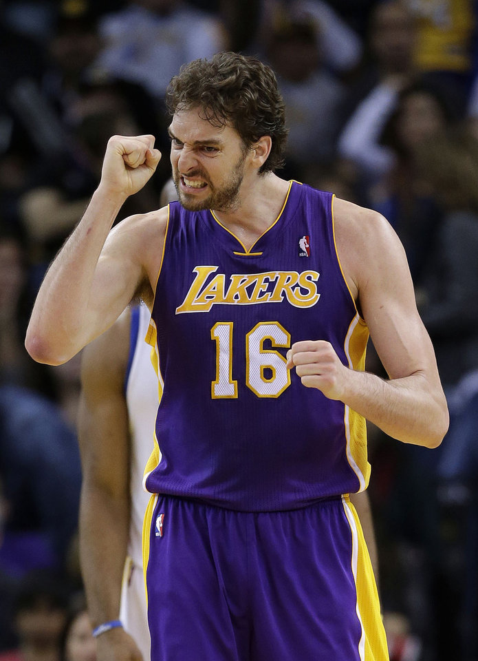 Los Angeles Lakers\' Pau Gasol (16) celebrates after scoring against the Golden State Warriors during the second half of an NBA basketball game in Oakland, Calif., Saturday, Dec. 22, 2012. Los Angeles won in overtime 118-115. (AP Photo/Marcio Jose Sanchez)