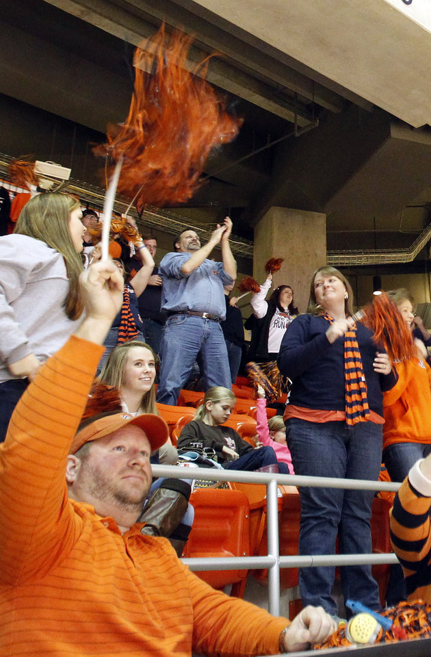 Photo - Austin Long, of Loxley, Ala. cheers with other Auburn fans after a touchdown as they watch the BCS National Championship NCAA college football game at Auburn Arena on Monday, Jan. 6, 2014, in Auburn, Ala. (AP Photo/Butch Dill)