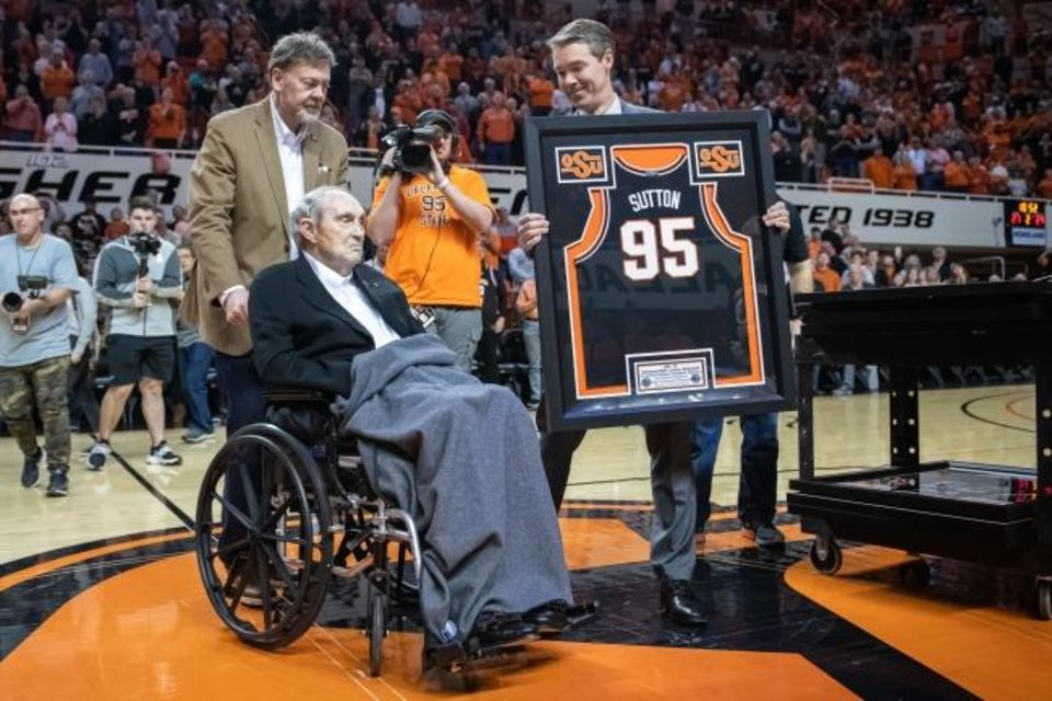 Photo -  Former OSU coach Eddie Sutton, center, is honored during halftime Saturday in Stillwater. [Rob Ferguson/USA TODAY Sports]