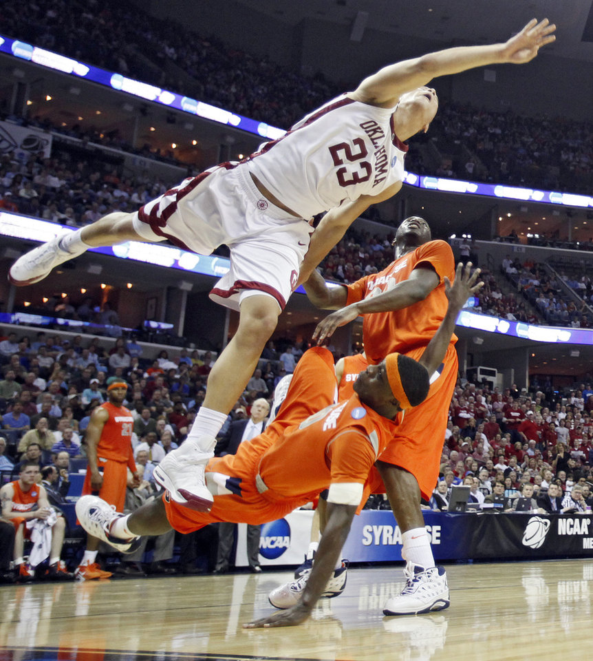 Oklahoma\'s Blake Griffin (23) goes over the top of Syracuse\'s Jonny Flynn (10) who is called for a blocking foul during the first half of the NCAA Men\'s Basketball Regional at the FedEx Forum on Friday, March 27, 2009, in Memphis, Tenn. PHOTO BY CHRIS LANDSBERGER, THE OKLAHOMAN