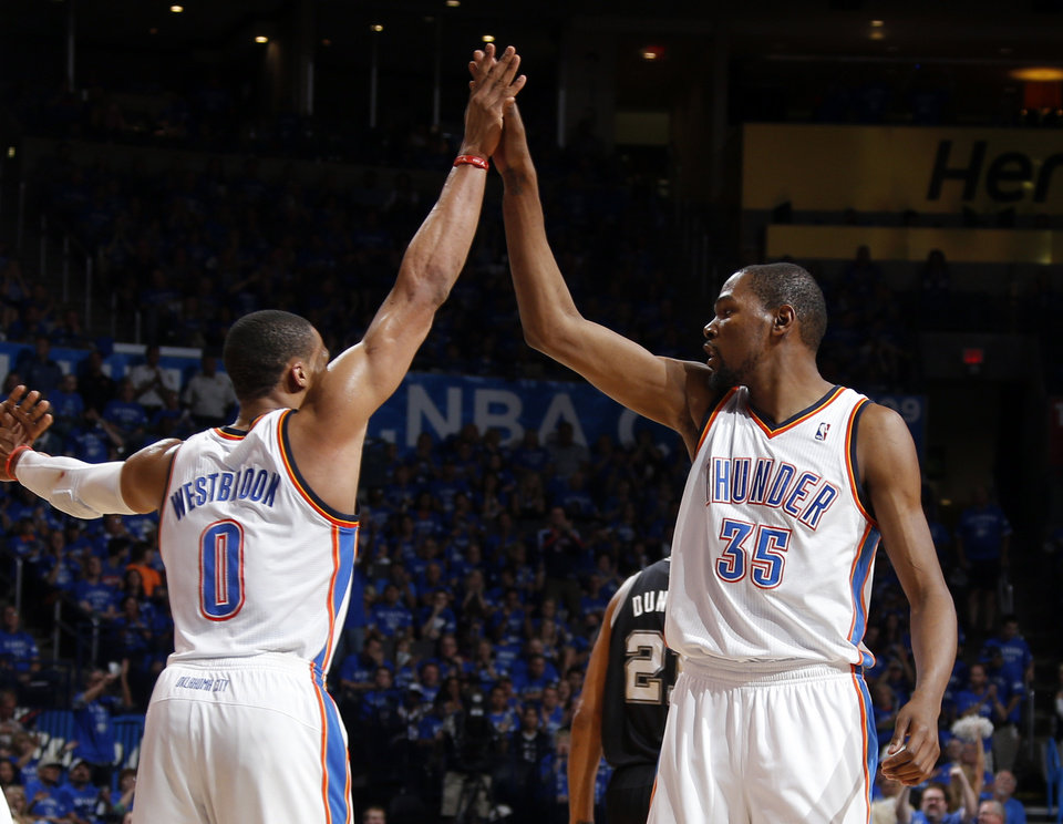 Photo - Oklahoma City's Russell Westbrook (0) and Kevin Durant (35) celebrate during Game 3 of the Western Conference Finals in the NBA playoffs between the Oklahoma City Thunder and the San Antonio Spurs at Chesapeake Energy Arena in Oklahoma City, Sunday, May 25, 2014. Photo by Bryan Terry, The Oklahoman