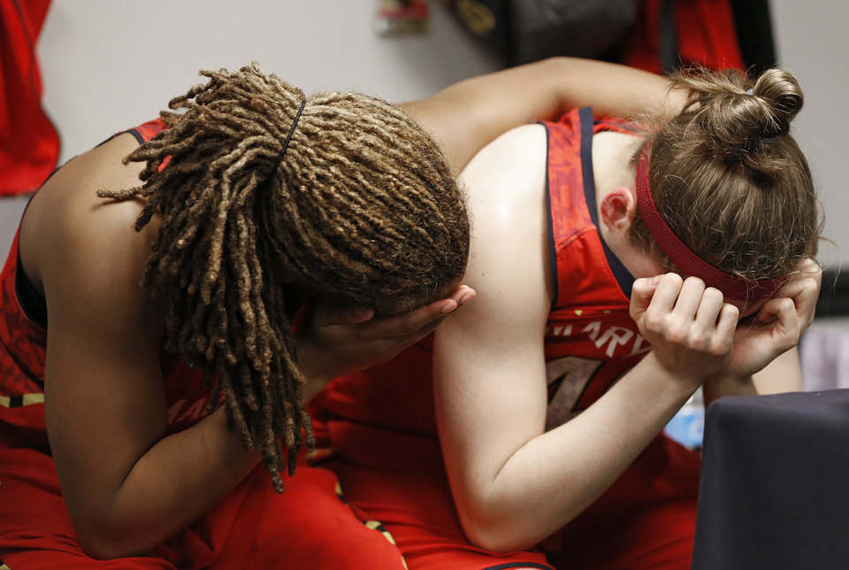 Photo - Maryland center Malina Howard, left and Sequoia Austin embrace after the semifinal game against Notre Dame in the Final Four of the NCAA women's college basketball tournament, Sunday, April 6, 2014, in Nashville, Tenn. Notre Dame won 87-61. (AP Photo/Mark Humphrey)