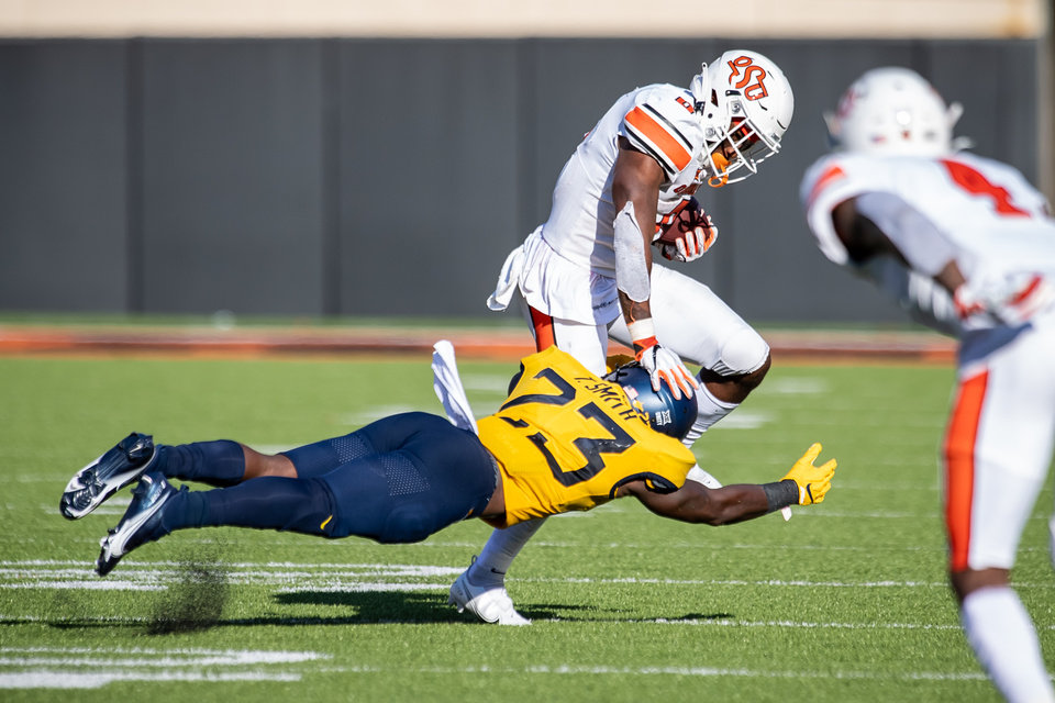 Photo - Oklahoma State Cowboys running back LD Brown (0) runs the ball during the second half at Boone Pickens Stadium. [Rob Ferguson/USA Today Sports]
