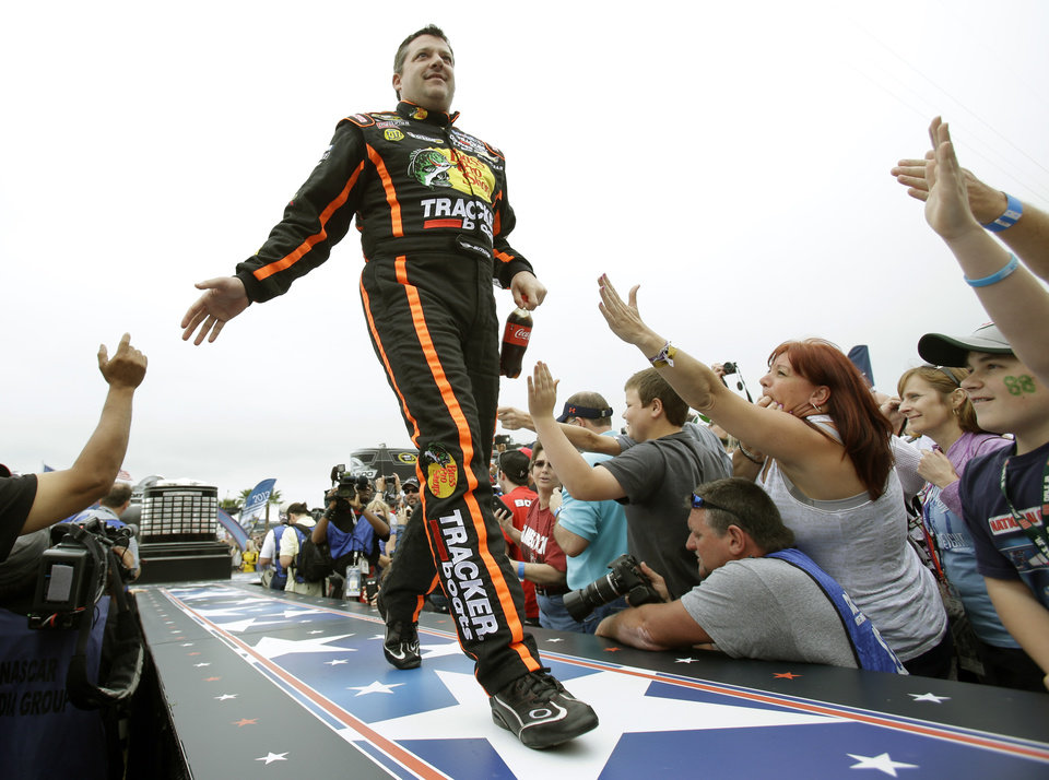 Photo - Tony Stewart greets fans during driver introductions before the NASCAR Daytona 500 Sprint Cup Series auto race at Daytona International Speedway, Sunday, Feb. 24, 2013, in Daytona Beach, Fla. (AP Photo/John Raoux)