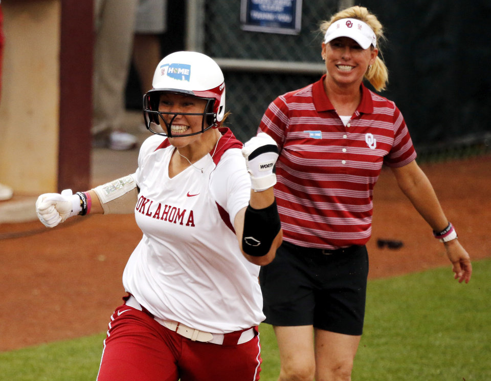 Photo - Sooner pitcher Keilani Ricketts comes home after a home run to end the game at the NCAA Super Regional softball game as the University of Oklahoma (OU) Sooners defeats Texas A&M 10-2 at Marita Hines Field on Friday, May 24, 2013 in Norman, Okla. Photo by Steve Sisney, The Oklahoman