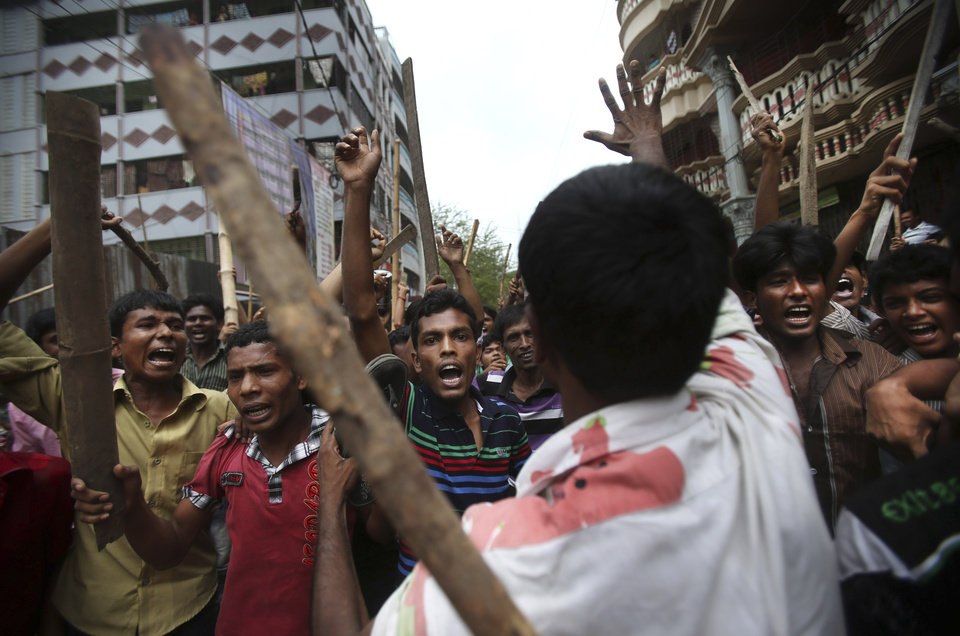 Photo - Protestors march down the street, demanding the death penalty for those responsible for the April 24 collapse of a garment factory building that killed hundreds in Savar, near, Dhaka, Bangladesh, Tuesday, April 30, 2013. A top Bangladesh court on Tuesday ordered the government to