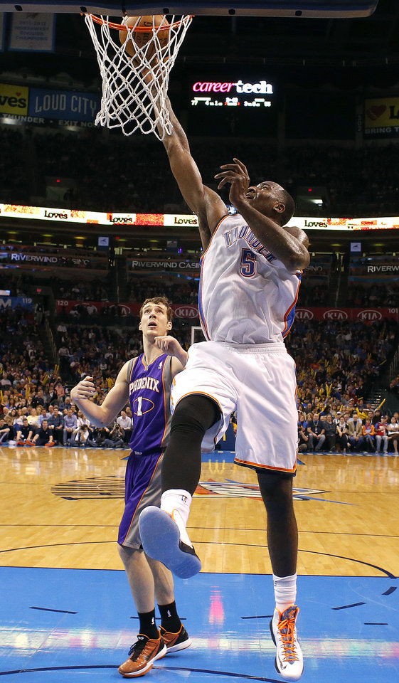 Photo - Oklahoma City's' Kendrick Perkins (5) shoots in from of Phoenix 's Goran Dragic (1) during the NBA game between the Oklahoma City Thunder and the Phoenix Suns at theChesapeake Energy Arena, Friday, Feb. 8, 2013.Photo by Sarah Phipps, The Oklahoman
