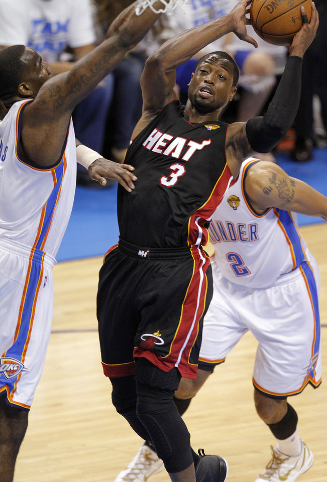 Miami's Dwyane Wade (3) shoots over Oklahoma City's Kendrick Perkins (5) during Game 2 of the NBA Finals between the Oklahoma City Thunder and the Miami Heat at Chesapeake Energy Arena in Oklahoma City, Thursday, June 14, 2012. Photo by Chris Landsberger, The Oklahoman