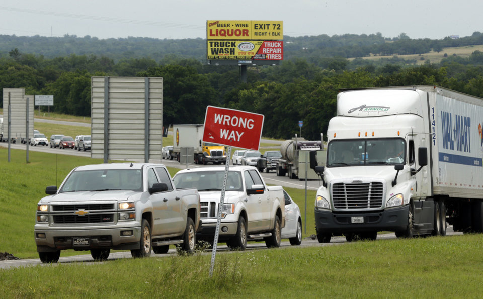 Photo - Southbound traffic is diverted off Interstate 35 at State Highway 7 on Thursday, June 18, 2015 in Davis, Okla. Photo by Steve Sisney, The Oklahoman