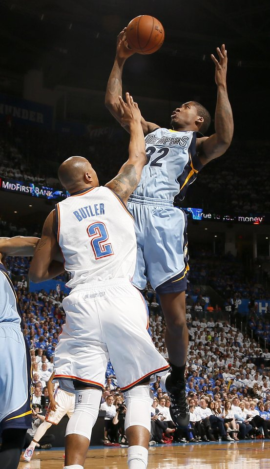 Photo - Memphis' Ed Davis (32) reaches for the ball over Oklahoma City's Caron Butler (2) during Game 2 in the first round of the NBA playoffs between the Oklahoma City Thunder and the Memphis Grizzlies at Chesapeake Energy Arena in Oklahoma City, Monday, April 21, 2014. Photo by Nate Billings, The Oklahoman