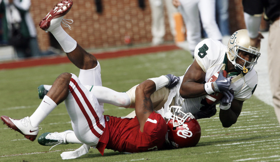Photo - Dominique Franks (1) tackles receiver David Gerris during the first half of the college football game between The University of Oklahoma Sooners (OU) and the Baylor Bears at the Gaylord Family-Oklahoma Memeorial Stadium on Saturday, Oct. 10, 2009, in Norman, Okla.