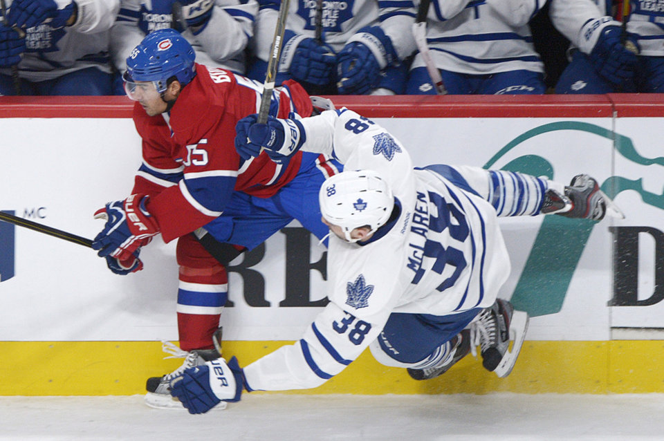 Montreal Canadiens' Francis Bouillon (55) collides with Toronto Maple Leafs' Frazer McLaren during the first period of an NHL hockey game in Montreal, Saturday, Feb. 9, 2013. (AP Photo/The Canadian Press, Graham Hughes)
