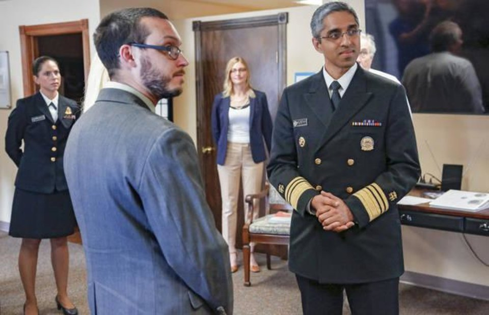 Photo - Justin Zagaruyka, left, speaks with Surgeon General Vivek Murthy during a tour of the Catalyst Behavioral Services treatment center in Oklahoma City, Okla. on Monday, May 16, 2016, where Zagaruyka receives treatment. Murthy hosted a panel discussion on opioid abuse, and tour a treatment facility on his visit. Photo by Chris Landsberger, The Oklahoman