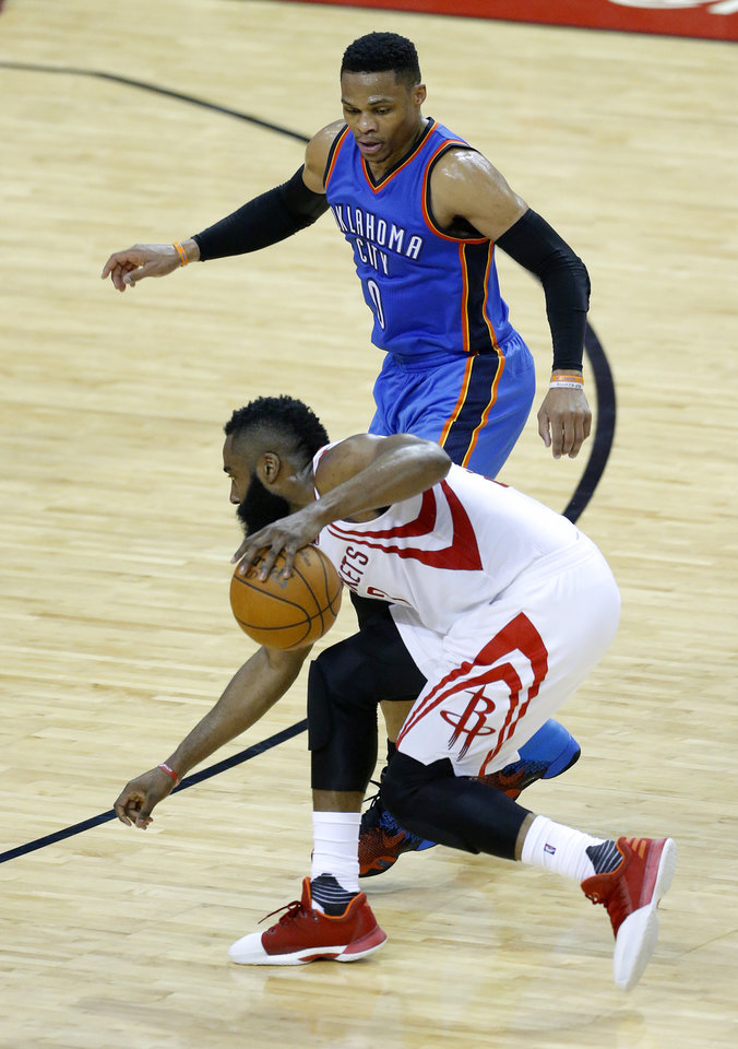 Photo - Oklahoma City's Russell Westbrook (0) defends against Houston's James Harden (13) during Game 5 in the first round of the NBA playoffs between the Oklahoma City Thunder and the Houston Rockets in Houston, Texas,  Tuesday, April 25, 2017.  Houston won 105-99. Photo by Sarah Phipps, The Oklahoman