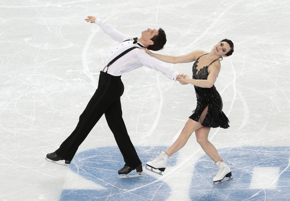 Photo - Tessa Virtue and Scott Moir of Canada compete in the ice dance short dance figure skating competition at the Iceberg Skating Palace during the 2014 Winter Olympics, Sunday, Feb. 16, 2014, in Sochi, Russia. (AP Photo/Ivan Sekretarev)