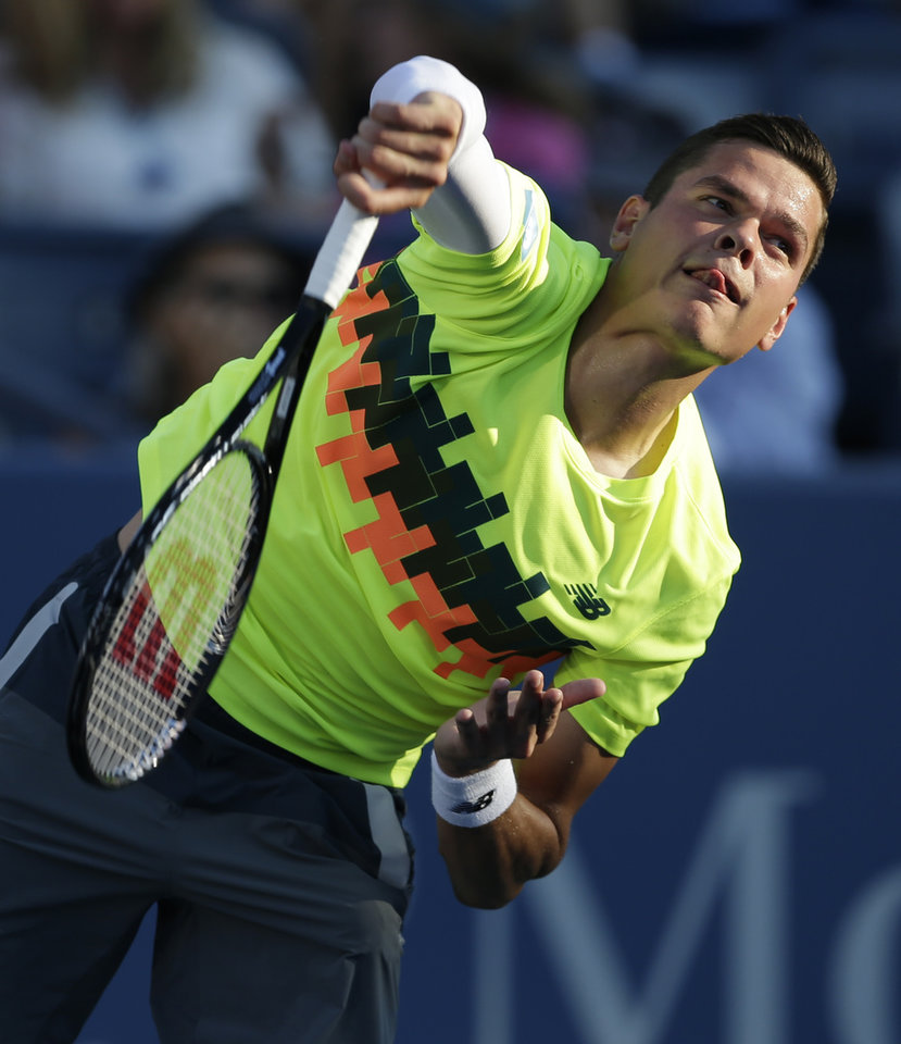 Photo - Milos Raonic, of Canada, serves to Taro Daniel, of Japan, during the opening round of the U.S. Open tennis tournament Monday, Aug. 25, 2014, in New York. (AP Photo/Darron Cummings)