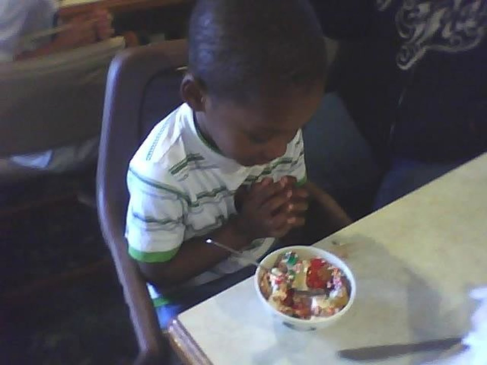 This is Royal at the place we ate lunch.. I noticed him saying his prayers and His mom and me became friends.. His daddy has been in jail for three jails will soon be out .. So pray for his family to all be okay.. He was so,so cute jAnd that was a prayer over icecream!!!!!!!!<br/><b>Community Photo By:</b> Tama<br/><b>Submitted By:</b> Tama, Midwest
