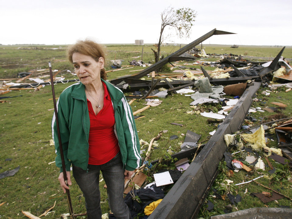 Photo - DAMAGE, AFTERMATH: Sweetwater resident Billie Boren stands in the remains of her daughter's house, Sunday, May 6, 2007, after a tornado swept through Sweetwater, Okla. the night before, destroying several homes and the local school. Photo by Paul Hellstern / The Oklahoman. ORG XMIT: KOD