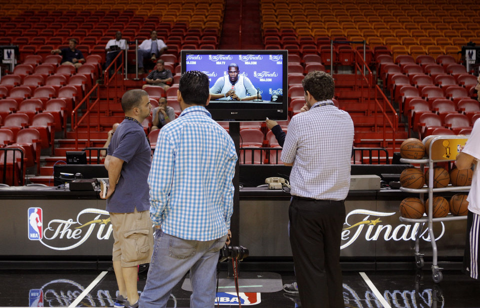 Photo - Reporters listen to a press conference with Oklahoma City's Kevin Durant before a practice for Game 5 of the NBA Finals between the Oklahoma City Thunder and the Miami Heat at American Airlines Arena, Wednesday, June 20, 2012. Photo by Bryan Terry, The Oklahoman