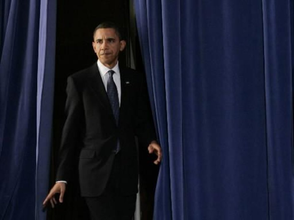 Photo - President Barack Obama walks onto the stage to speak about  Fort  Hood during an event at the Interior Department in Washington, Thursday, Nov. 5, 2009. Obama called the mass shooting at a Texas Army base