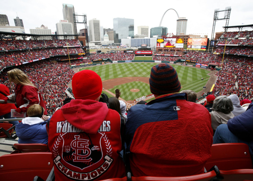 Photo - St. Louis Cardinals baseball fans watch pre-game festivities before a game between the Cardinals and the Pittsburgh Pirates on opening day in St. Louis Monday, April  6, 2009.  (AP Photo/Lynne Sladky) ORG XMIT: MOLS102