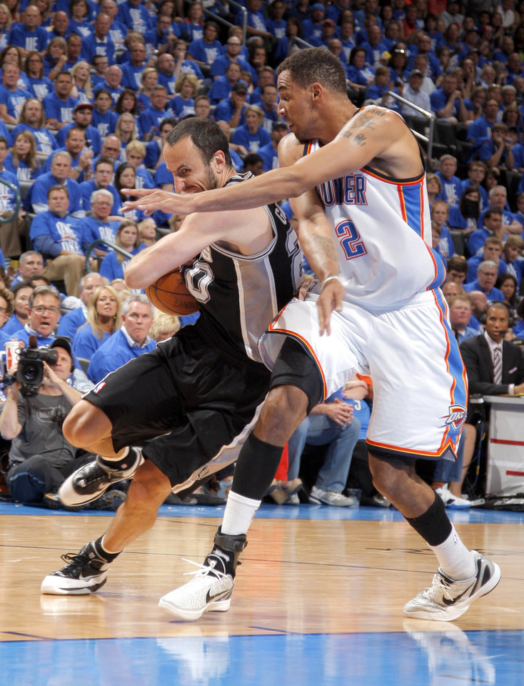 Photo - Oklahoma City's Thabo Sefolosha (2) defends against San Antonio's Manu Ginobili (20) during Game 3 of the Western Conference Finals between the Oklahoma City Thunder and the San Antonio Spurs in the NBA playoffs at the Chesapeake Energy Arena in Oklahoma City, Thursday, May 31, 2012.  Photo by Sarah Phipps, The Oklahoman