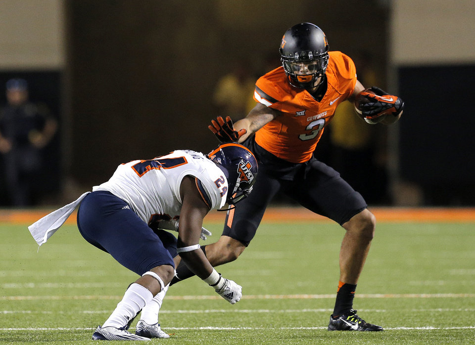 Photo - Oklahoma State's Marcell Ateman (3) gets by UTSA's Darrien Starling (24) during a college football game between the Oklahoma State University Cowboys (OSU) and the University of Texas at San Antonio Roadrunners (UTSA) at Boone Pickens Stadium in Stillwater, Okla., Saturday, Sept. 13, 2014. Photo by Sarah Phipps, The Oklahoman